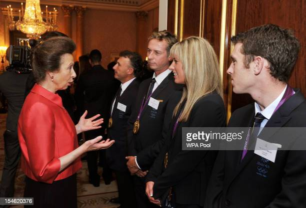 Princess Anne Princess Royal talks to Carl Hester Charlotte Dujardin and Scott Brash during a reception held for Team GB Olympic and Paralympic...