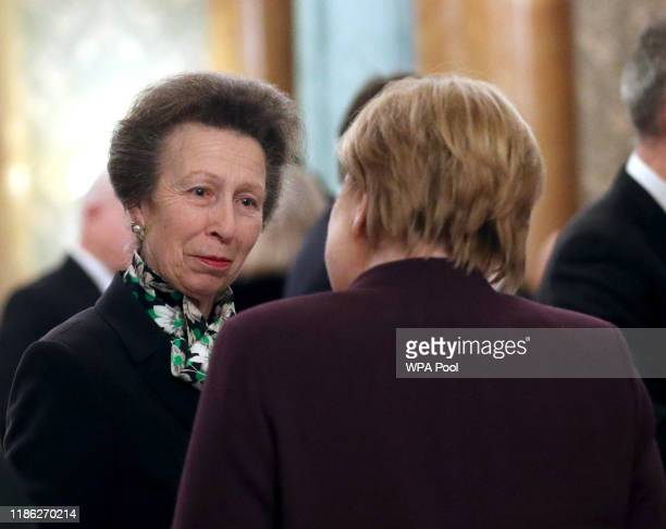 Princess Anne Princess Royal talks to Chancellor of Germany Angela Merkel at a reception for NATO leaders hosted by Queen Elizabeth II at Buckingham...