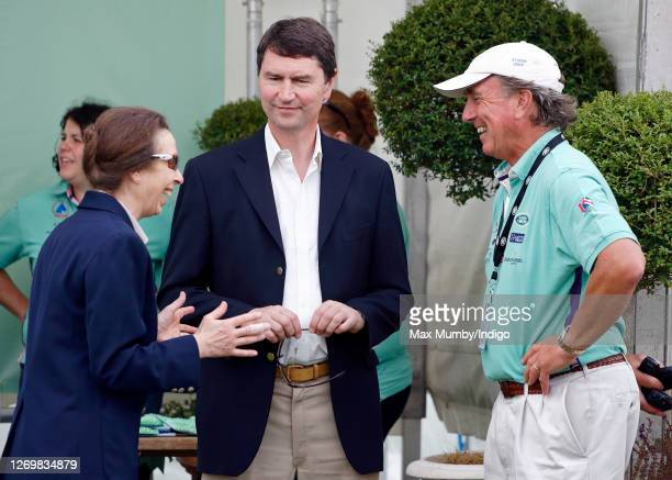 Princess Anne, Princess Royal talks with husband Vice Admiral Timothy Laurence and ex-husband Mark Phillips as they attend the Festival of British...