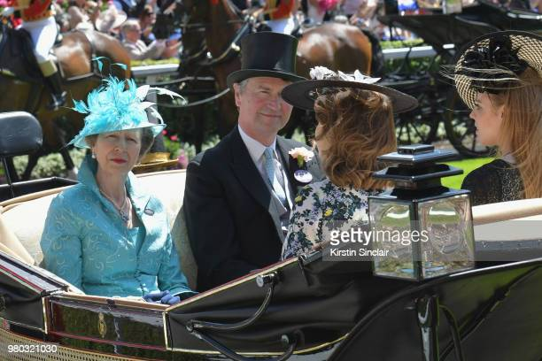 Princess Anne Princess Royal Vice Admiral Sir Tim Laurence Princess Eugenie of York and Princess Beatrice of York arrive in the Royal procession on...