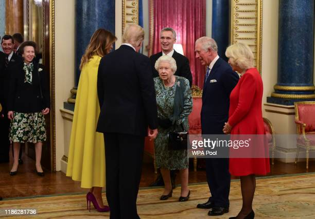 Princess Anne, Princess Royal watches as Queen Elizabeth II talks to US President Donald Trump and wife Melania as she hosts a reception for NATO...