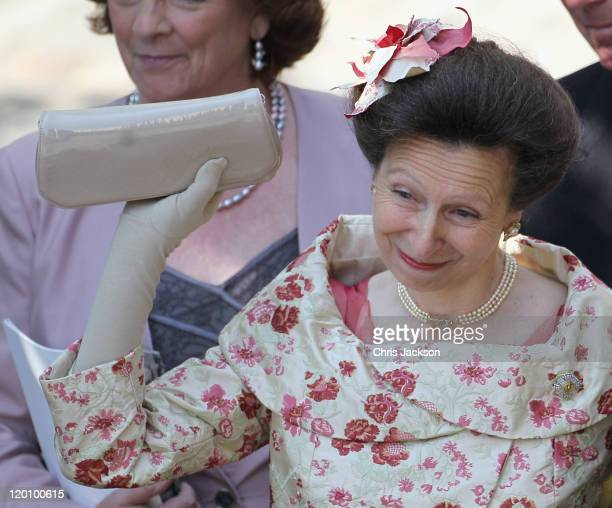 Princess Anne Princess Royal waves off Zara Philips as she eaves Canongate Kirk on the afternoon of her wedding to Mike Tindall on July 30 2011 in...