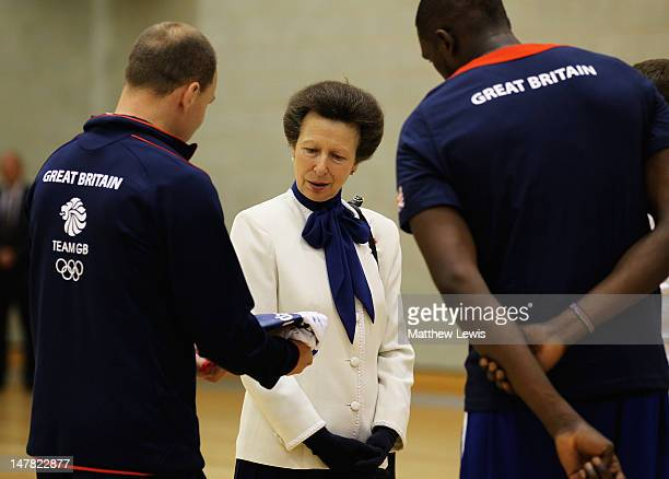 Princess Anne Princess Royal receives a signed shirt from Chris Finch Coach of the Mens GB Basketball team during the Team GB kitting out event ahead...