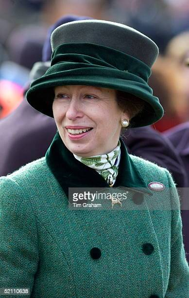 Princess Anne Smiling Despite It Being A Cold And Windy Day At The Cheltenham Festival. The Princess Has Chosen To Wear A Warm Green Tweed Coat And...
