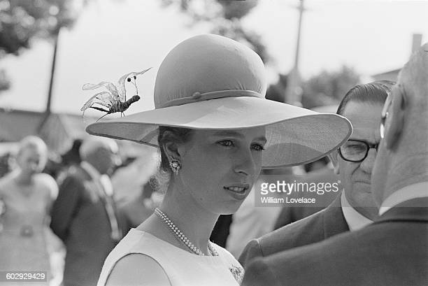 Princess Anne sports a widebrimmed hat with an artificial insect on it at a fashion show in Brisbane Australia April 1970