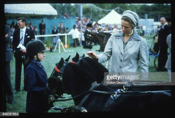 Princess Anne strokes a pony during her visit to the 1982 Greater London Horse Show on Clapham Common
