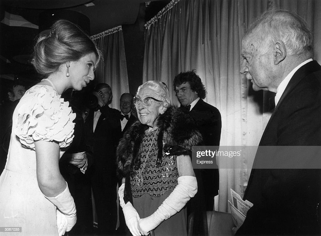 Princess Anne (Mrs Mark Phillips) talks to crime writer Agatha Christie (1890 - 1976) and her husband Sir Max Mallowan (1904 - 1978) at the world premier of 'Murder on the Orient Express' at the ABC cinema, Shaftesbury Avenue, London.