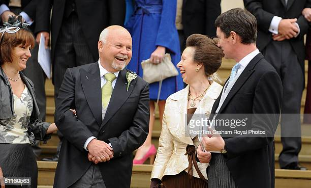 Princess Anne the Princess Royal and Commander Tim Laurence chat with Mr Brian Kelly Autumn's father at the wedding of Peter Phillips to Autumn Kelly...
