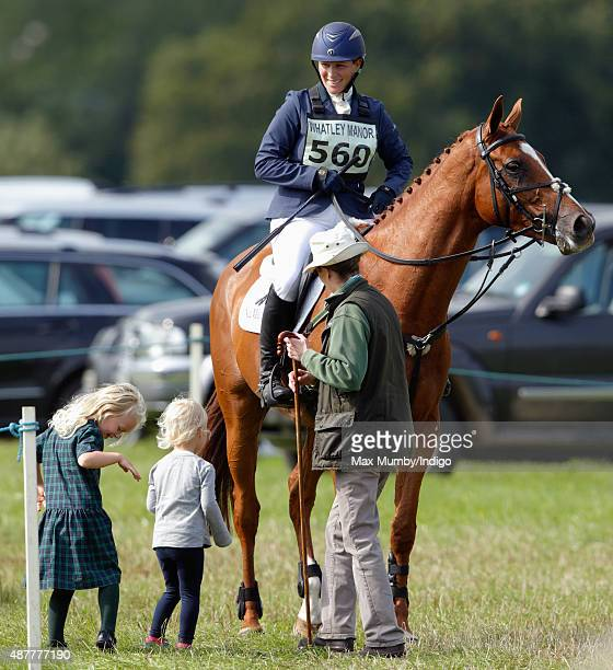 Princess Anne The Princess Royal and her grandchildren Isla Phillips and Savannah Phillips talk with Zara Phillips after she competed in the show...