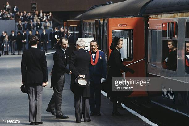Princess Anne the Princess Royal and her husband Mark Phillips board a train at Waterloo Station in London after attending the funeral of Lord...