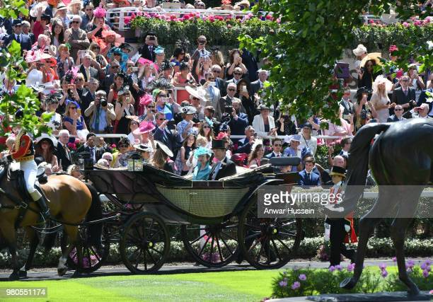 Princess Anne, the Princess Royal and Sir Tim Laurence arrive in an open carriage to attend the third day of Royal Ascot on June 21, 2018 in Ascot,...