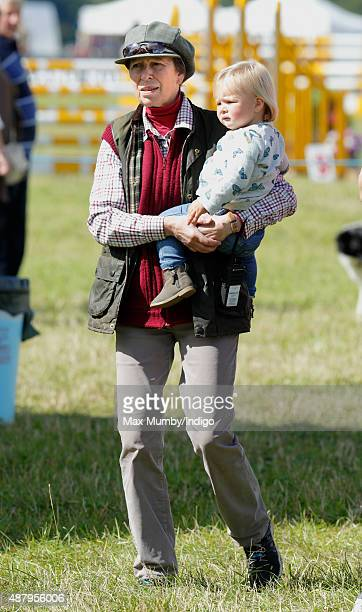 Princess Anne The Princess Royal carries her granddaughter Mia Tindall as she attends day 2 of the Whatley Manor International Horse Trials at...