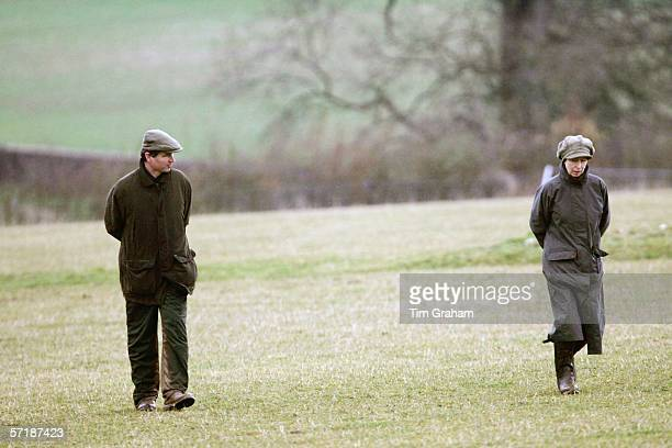 Princess Anne, the Princess Royal in Barbour style raincoat and wellington boots with husband Tim Laurence trudges through thick mud at the British...