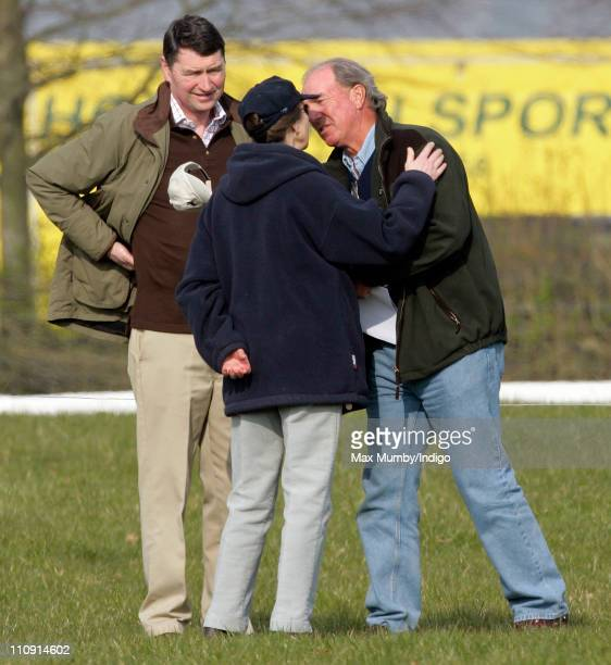 Princess Anne The Princess Royal kisses her exhusband Mark Phillips as her current husband ViceAdmiral Tim Laurence looks on at the Gatcombe Park...