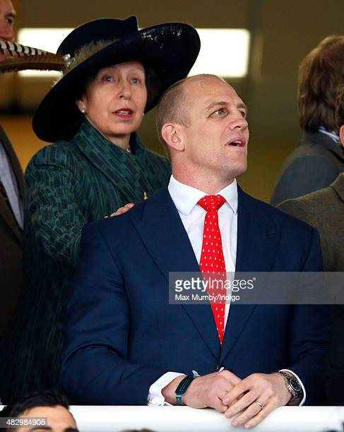 Princess Anne The Princess Royal pats soninlaw Mike Tindall on the shoulder as they watch Mike Tindall's horse Monbeg Dude run in the Crabbie's Grand...