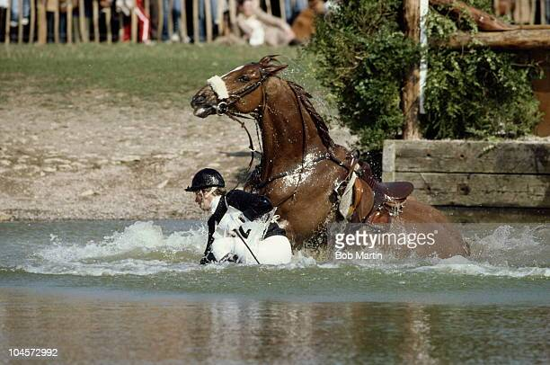 HRH Princess Anne The Princess Royal riding Stevie B falls at the water jump during the cross country equestrian event at the Badminton Horse Trials...