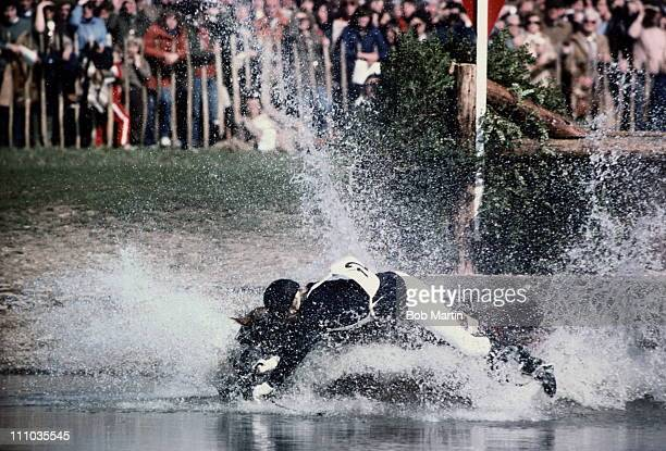 Princess Anne, The Princess Royal, riding Stevie B falls at the water jump during the cross country equestrian event at the Badminton Horse Trials on...