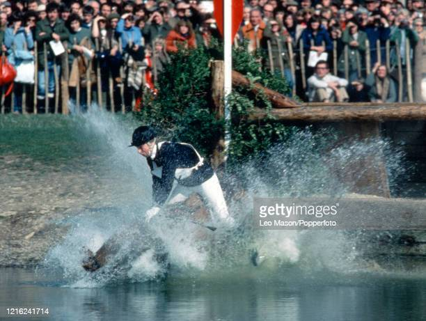 Princess Anne, The Princess Royal, riding Stevie B falls at the water jump during the cross country section of the equestrian three-day event at the...