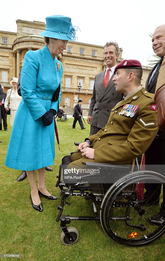 Princess Anne, The Princess Royal talks to Cpl Ben Parkinson who lost both legs in Afghanistan in 2006 at the Not Forgotten Association Garden Party for injured ex servicemen and women, in the Buckingham Palace Garden on July 2, 2013 in London, England.