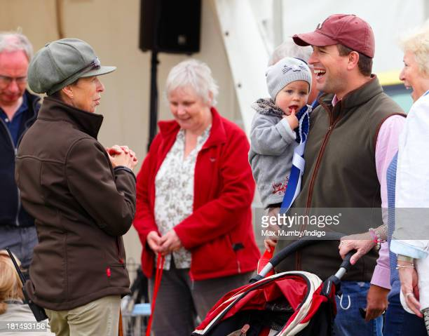 Princess Anne The Princess Royal talks with son Peter Phillips and granddaughter Isla Phillips as they attend the Gatcombe Horse Trials at Gatcombe...