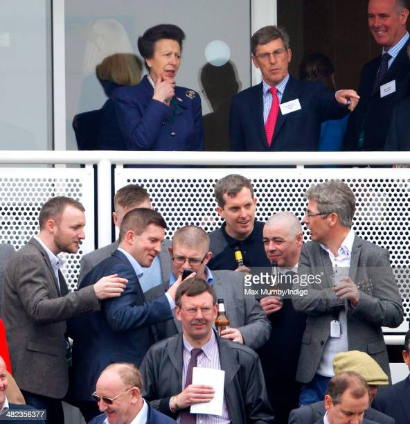 Princess Anne The Princess Royal watches the racing as she attends day 1 of the Crabbie's Grand National horse racing meet at Aintree Racecourse on...