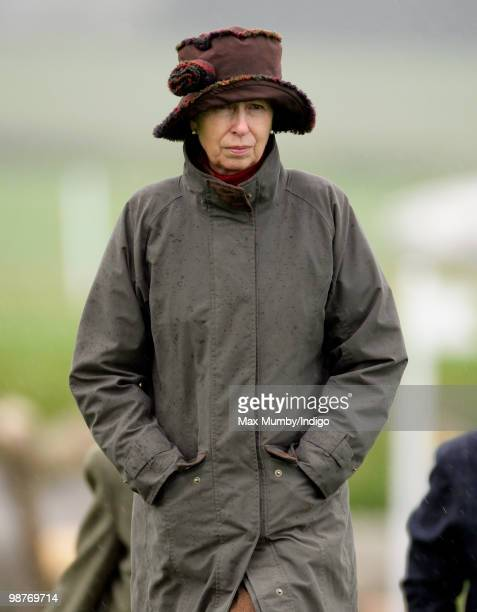 Princess Anne, The Princess Royal wears a hat and raincoat as she gets caught in a rain shower whilst attending the Badminton Horse Trials on April...