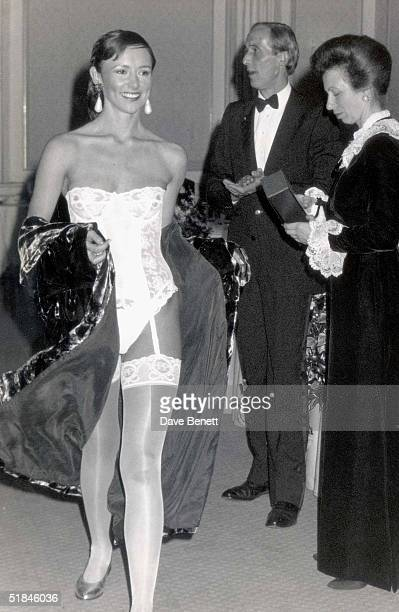 Princess Anne watches a model at the annual British Apparel Export Awards 1999 at The Grosvenor Hotel in London. The awards, now in their fifth year,...