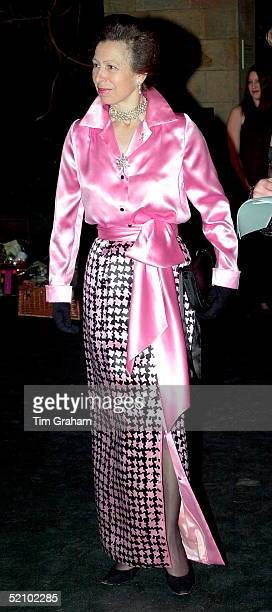 Princess Anne Wearing A Striking Pink Satin Shirt With A Black And Pink Long Satin Skirt Which Is Split To The Knee At The Front She Is Attending The...
