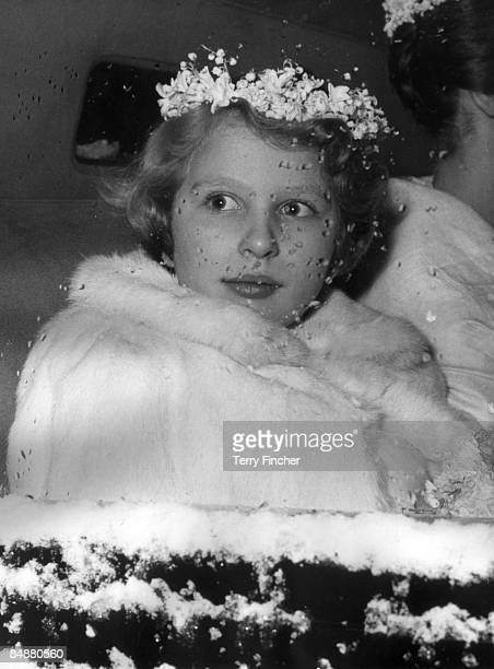 Princess Anne wearing a white fur coat and a wreath of snowdrops 1960
