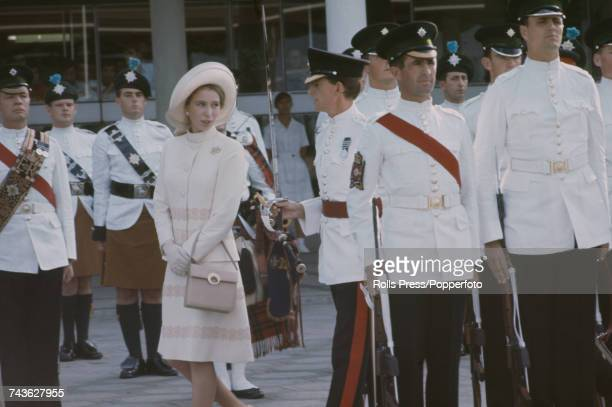 Princess Anne wearing an ivory jacket skirt and matching hat is escorted by members of the Hong Kong Garrison part of British Forces Overseas Hong...