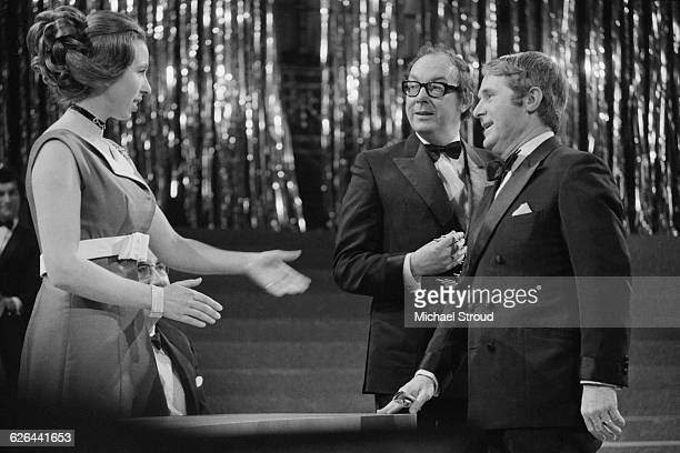 Princess Anne with comedians Eric Morecambe and Ernie Wise at the Society of Film and Television Arts Awards at the Albert Hall London 4th March 1971...