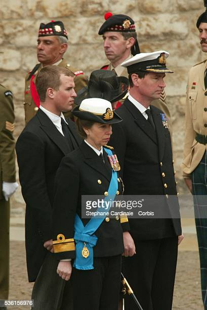 Princess Anne with her husband Tim Laurence and son Peter Phillips leave Westminster Abbey following the funeral of the Queen Mother.