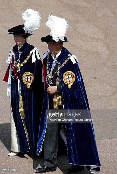 Princess Anne With King Harald Of Norway, Dressed In Garter Robes, Walking To St George's Chapel For The Annual Order Of The Garter Ceremony.