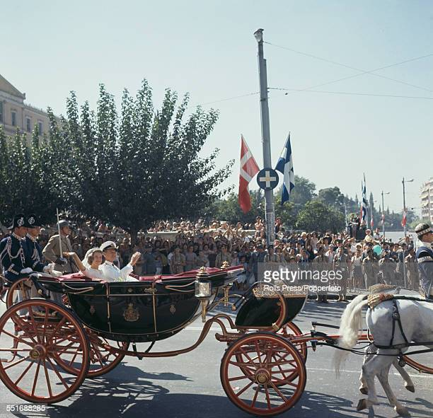 Princess AnneMarie of Denmark travels through the streets of Athens with her father King Frederick IX of Denmark in a horse drawn carriage on the day...