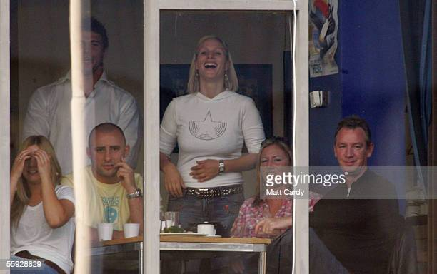 Princess Anne's daughter Zara Phillips laughs as she watches boyfriend Mike Tindall play rugby in the Bath v Gloucester match at Bath Recreation...