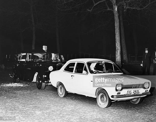 Princess Anne's RollsRoyce and a white Ford Escort car used by wouldbe kidnapper Ian Ball to force the royal car to stop in a failed attempt to...