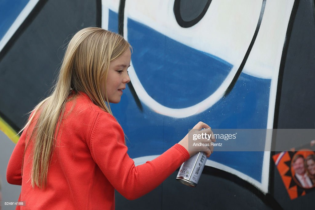 Princess Ariane of The Netherlands spray painting during King's Day (Koningsdag), the celebration of the birthday of the Dutch King, on April 27, 2016 in Zwolle, Netherlands. Parties and concerts are held across the Netherlands as members of the Dutch royal family oversee festivities.