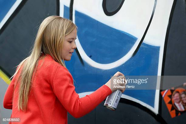 Princess Ariane of The Netherlands sprays graffiti during King's Day , the celebration of the birthday of the Dutch King, on April 27, 2016 in...