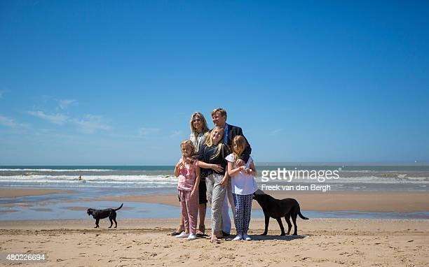 Princess Ariane, Queen Maxima, Princess Amalia, King Willem-Alexander and Princess Alexia of The Netherlands and their dogs pose for pictures on July...