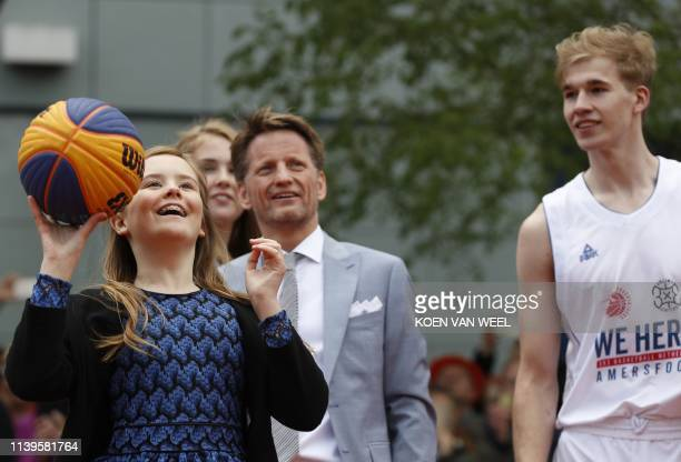 Princess Ariane throws a ball during a visit to Amersfoort on Kings Day on April 27, 2019. - The king celebrates his birthday in the city in central...