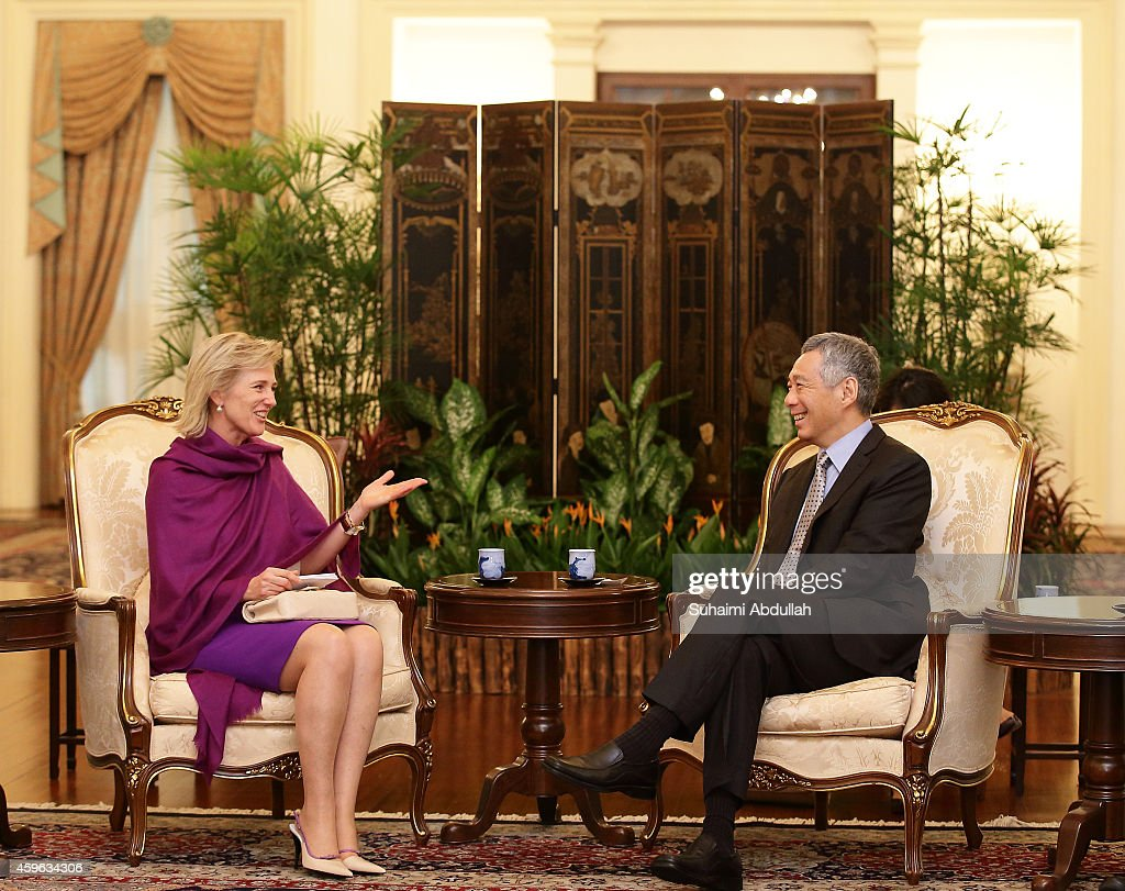 Princess Astrid Of Belgium (L) calls on Prime Minister of Singapore, Lee Hsien Loong at the Istana on November 27, 2014 in Singapore. Princess Astrid Of Belgium is in Singapore for a three days official visit to promote economic and research development between the two countries.