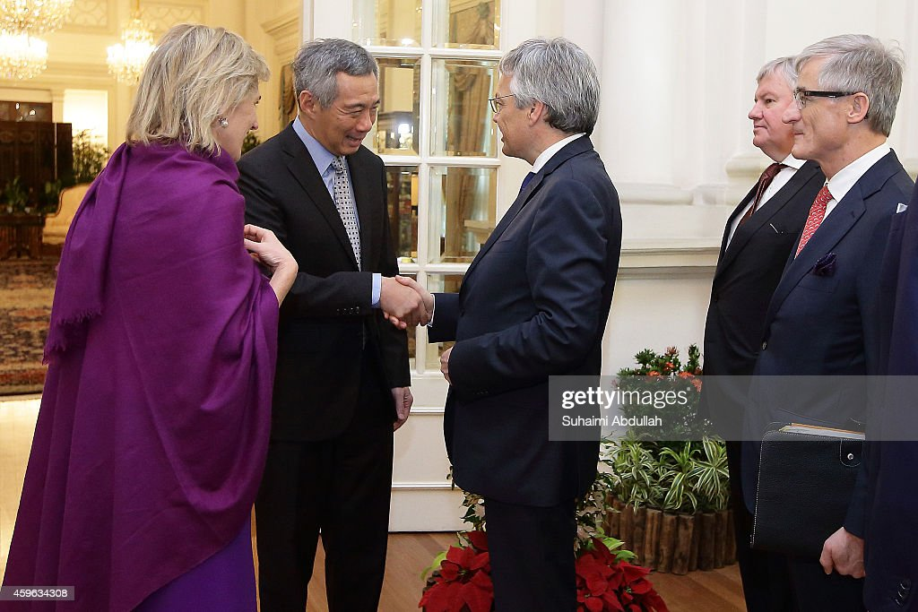 Princess Astrid Of Belgium (L) introduces Deputy Prime Minister and Minister of Foreign Affairs and European Affairs, Didier Reynders (3L) to Prime Minister of Singapore, Lee Hsien Loong (2L) as Minister-President of Flanders, Geert Bourgeois and Vice-President and Minister of Economy for Wallonia, Jean-Claude Marcourt look on at the Istana on November 27, 2014 in Singapore. Princess Astrid Of Belgium is in Singapore for a three days official visit to promote economic and research development between the two countries.