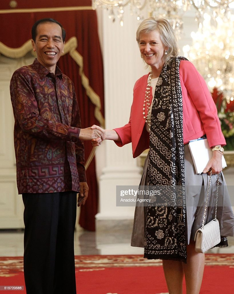 Princess Astrid (R) of Belgium shakes hands with Indonesian President Joko Widodo (L) during their meeting in Jakarta, Indonesia on March 15, 2016.