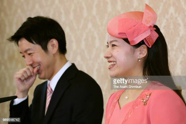 Princess Ayako of Takamado and her fiance Kei Moriya shake a laugh during a press conference on their engagement at the Imperial Household Agency on...