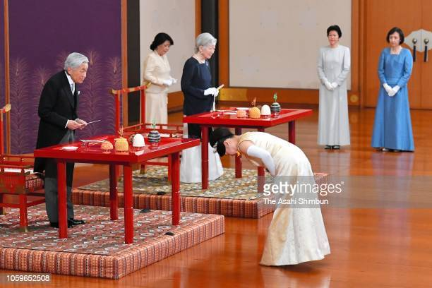 Princess Ayako of Takamado greets Emperor Akihito and Empress Michiko during the 'ChokennoGi' greeting ceremony at the Imperial Palace ahead of the...