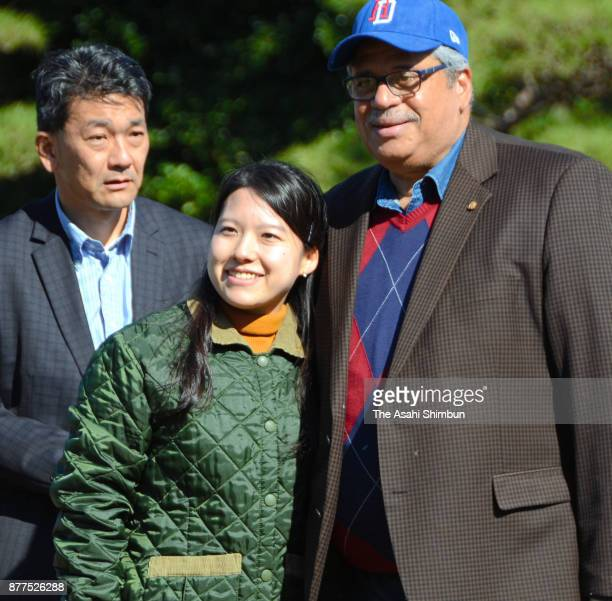 Princess Ayako of Takamado poses for photographs with a guest as she invites foreign diplomats and their partners to Shinhama Kamoba on November 16...