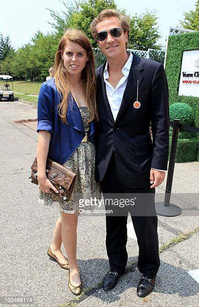 Princess Beatrice and Dave Clark pose for a photograph as they attend the 2010 Veuve Clicquot Manhatten Polo Classic on Governor's Island on June 27...