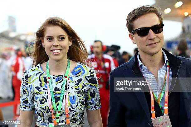 Princess Beatrice and David Clark walk across the grid during the Bahrain Formula One Grand Prix at Bahrain International Circuit on April 19 2015 in...