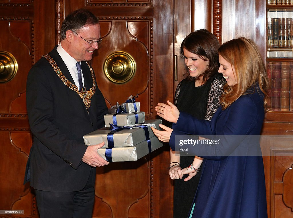 Princess Beatrice and Princess Eugenie are presented with gifts by Mayor of Hanover Stephan Weil at Hanover City Hall on January 18, 2013 in Hanover, Germany. The royal sisters are in Hanover on the second day of a two day visit to Germany.Yesterday the royals were in Berlin helping support GREAT, the British Government's initiative promoting the UK abroad.