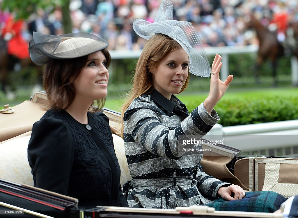 Princess Beatrice (R) and Princess Eugenie arrive in an open carriage during Day 1 of Royal Ascot at Ascot Racecourse on June 18, 2013 in Ascot, England.